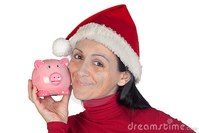 Beautiful girl in Christmas loving moneybox