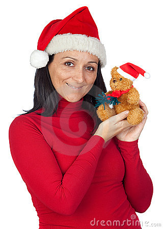 Beautiful girl with a Christmas teddy bear