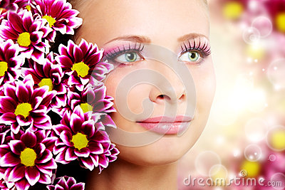 Beautiful girl with chrysanthemum