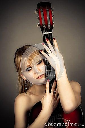girl covers naked body guitar