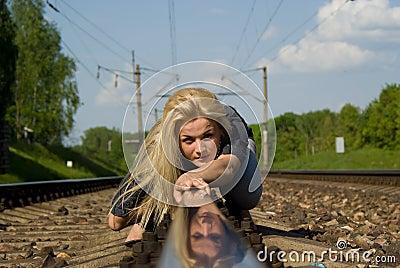 Beautiful girl crawl on rails