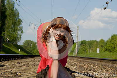 Beautiful girl crawl on rails
