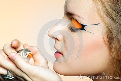 Beautiful girl with creative makeup and bird