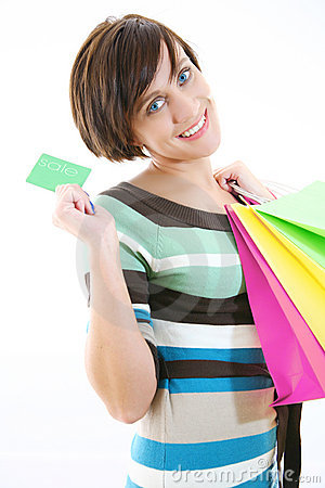 Beautiful girl with credit card and shopping bags