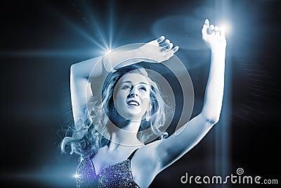 Beautiful girl dancing in club disco
