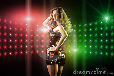 Beautiful girl dancing in club disco