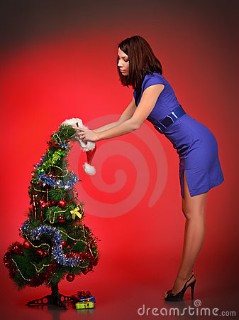 Beautiful girl decorating christmas tree