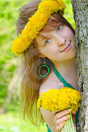 Beautiful girl with diadem from yellow dandelions
