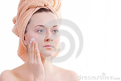 Beautiful girl does cream