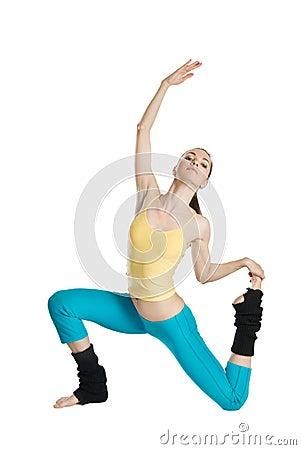 Beautiful girl doing gymnastics on white