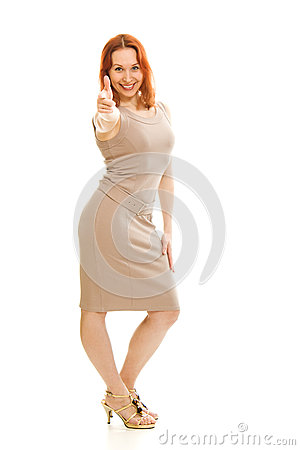 Beautiful girl in a dress shows okay