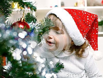 Beautiful girl dressed in a Santa Claus hat