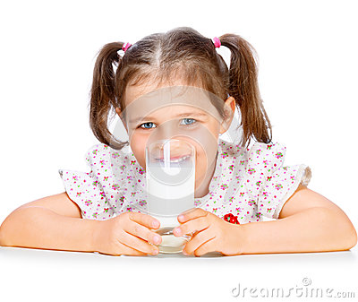 Beautiful girl drinking milk
