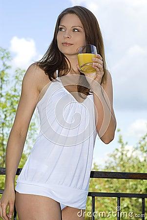 Free Beautiful Girl Drinking Morning Orange On Balcony Stock Images - 5216964