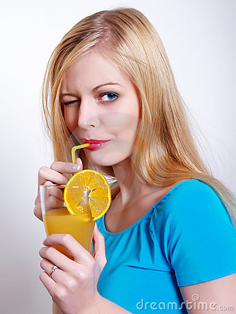 The beautiful girl drinks juice