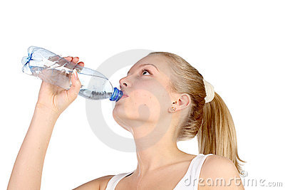 Beautiful girl drinks mineral water