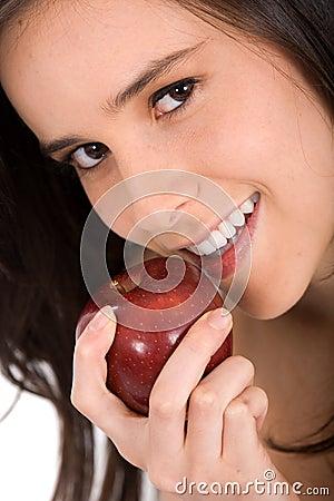 Beautiful girl eating an apple