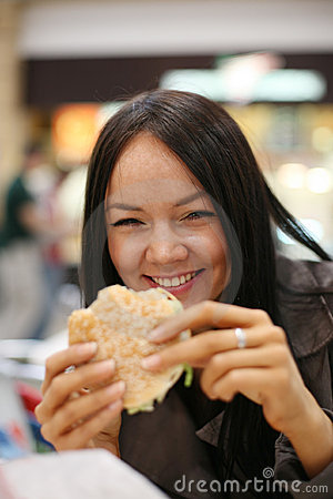 Free Beautiful Girl Eating Burger Stock Image - 3272661