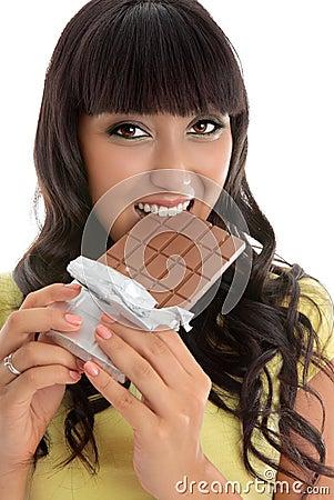 Beautiful girl eating decadent chocolate bar