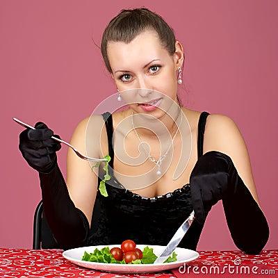 Beautiful girl eating fresh healthy