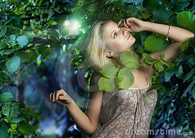 Beautiful girl in the fairy forest