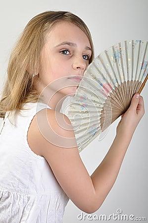 Beautiful girl with a fan