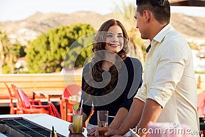 Beautiful girl flirting at a bar