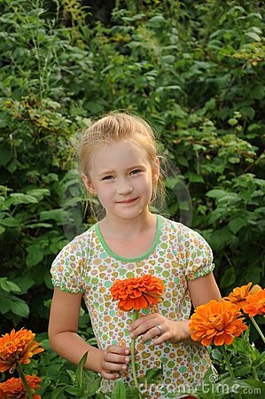 Beautiful girl in the flowers