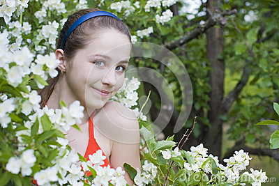 Beautiful girl among flowers