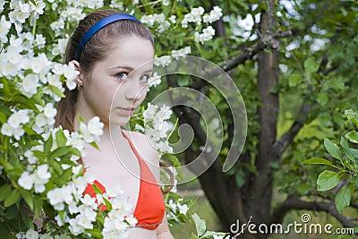 Beautiful girl among flowers