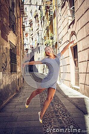 Free Beautiful Girl Flying Through Cagliari Streets In Sardinia Royalty Free Stock Photos - 90515118