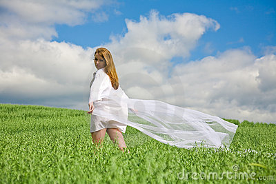 Beautiful girl with flying white shawl