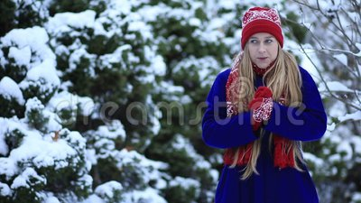 Beautiful girl freezing in winter forest stock video