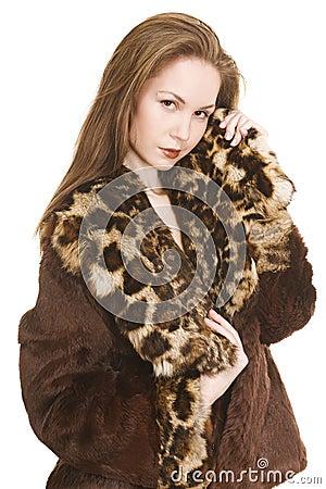 Beautiful girl in fur coat