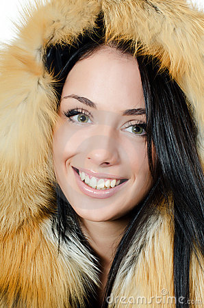 Beautiful girl in a fur hood