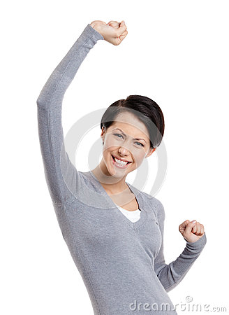 Beautiful girl gestures triumphal fists