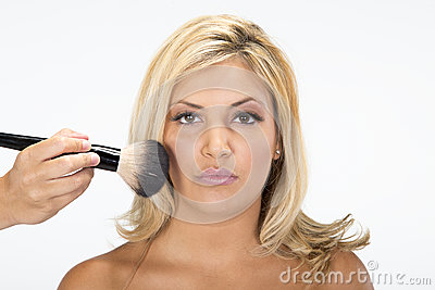 Beautiful girl gets her makeup done