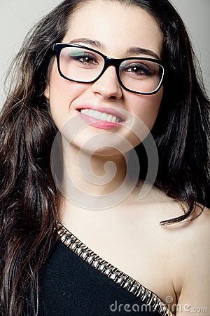 Beautiful girl with glasses smiling