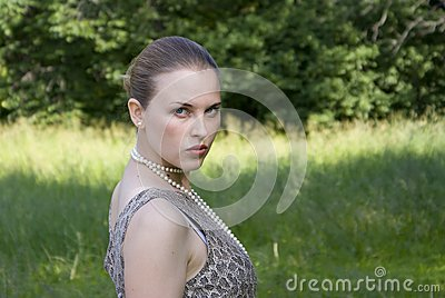 Beautiful girl on a green wood background