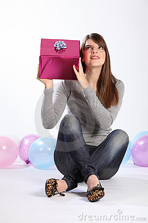 Beautiful girl guessing mystery birthday present