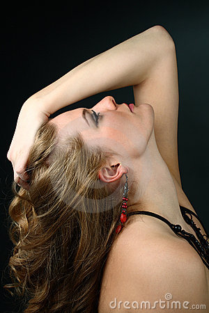 Beautiful girl with hand in her hair looking up