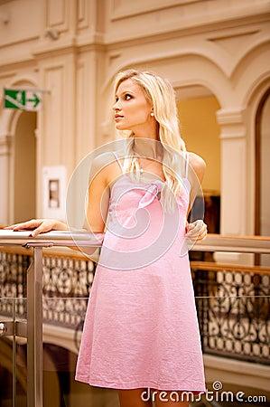 Beautiful girl at handrail