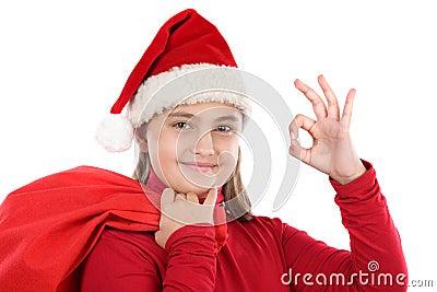 Beautiful girl with hat of christmas saying OK