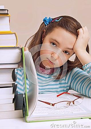 Beautiful girl having a lot of homework