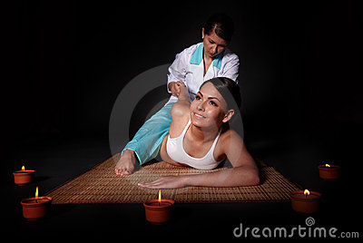 Beautiful  girl having thai massage.
