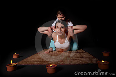 Beautiful girl having thai massage.