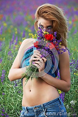 Beautiful girl hiding behing flowers