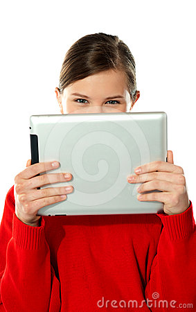 Beautiful girl hiding her face with touch pad