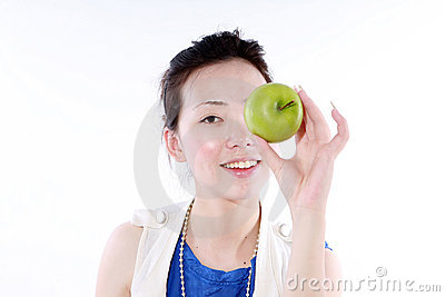 Beautiful girl holding with apple