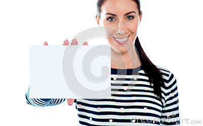 Beautiful girl holding blank card. Copyspace